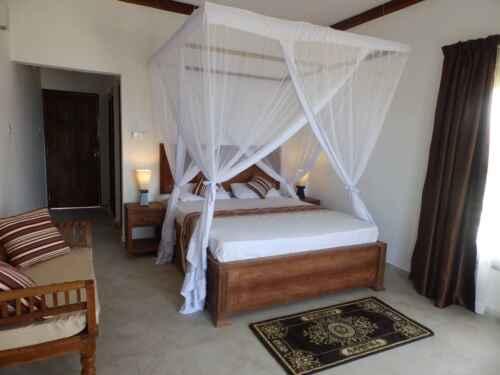 habitación del hotel baharivillas - Baharytravels